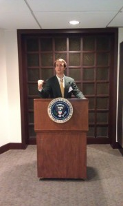 "Behm during his visit to Rice. He is standing at the same podium JFK gave his ""Go to the Moon"" speech."