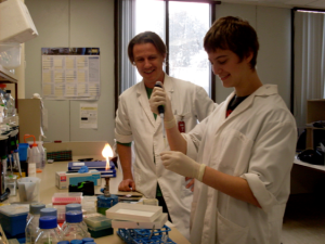 Kaplan (right) in Canberra, Australia preforming research on platypus sex chromosomes.