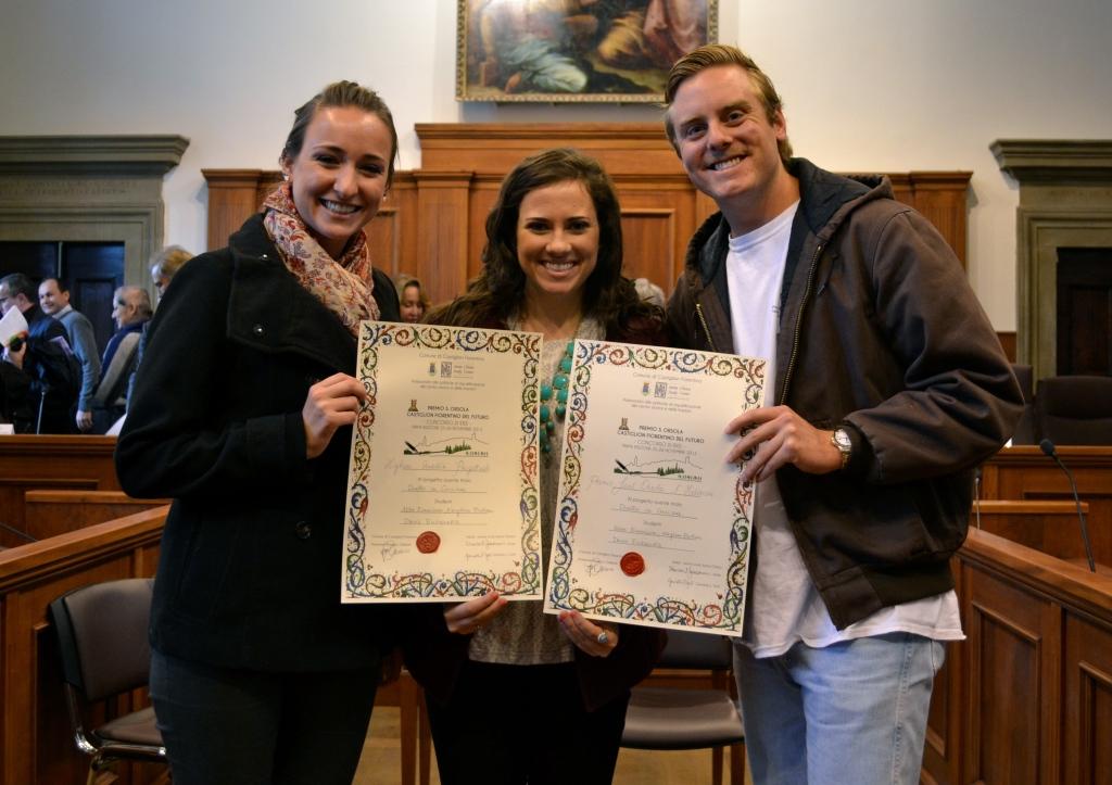 TAMU Students hold award certificates