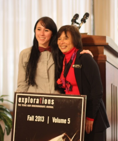 Annabelle Aymond (left) and Dr. Suma Datta (right), Executive Director for Honors and Undergraduate Research pose with the latest Explorations cover art.
