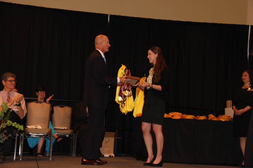 HSC President Kathryn Kudlaty presents the 2014 Wells Fargo Honors Faculty Mentor Award to Dr. Don Curtis