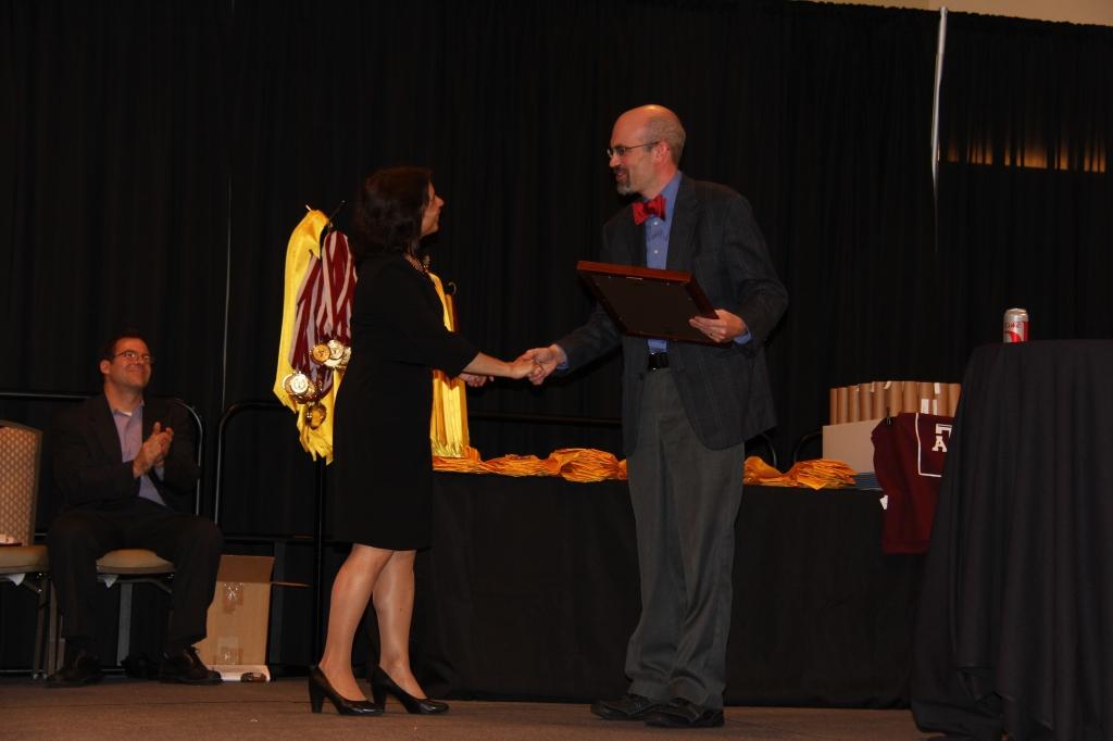 Dr. Suma Datta presents the 2014 Unterberger Award to Dr. Chris Quick