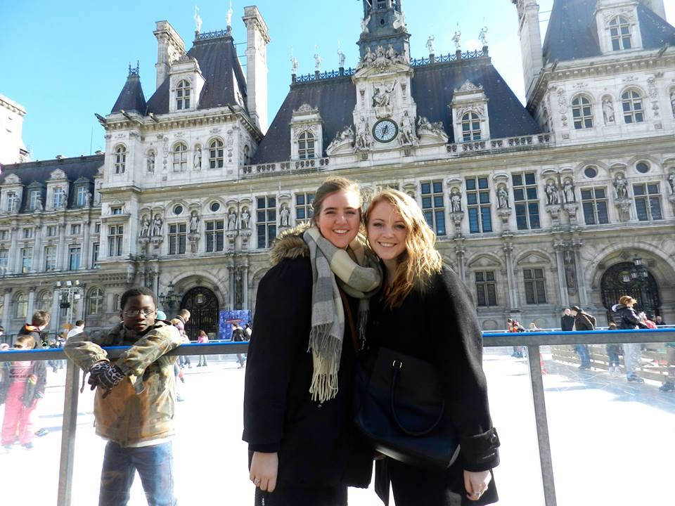 Shelbi Polk '15 and her friend Adrienne pose in front of the Hôtel de Ville, Paris