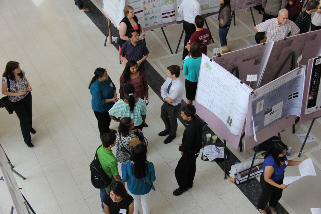 Students explain the results of their research projects.