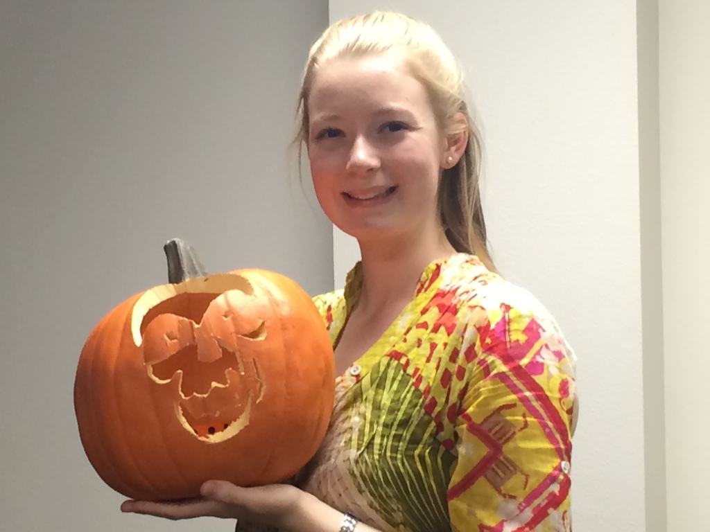 University Scholar Adelia Humme '15 displays a pumpkins she carved as part of the Art Exploration series.