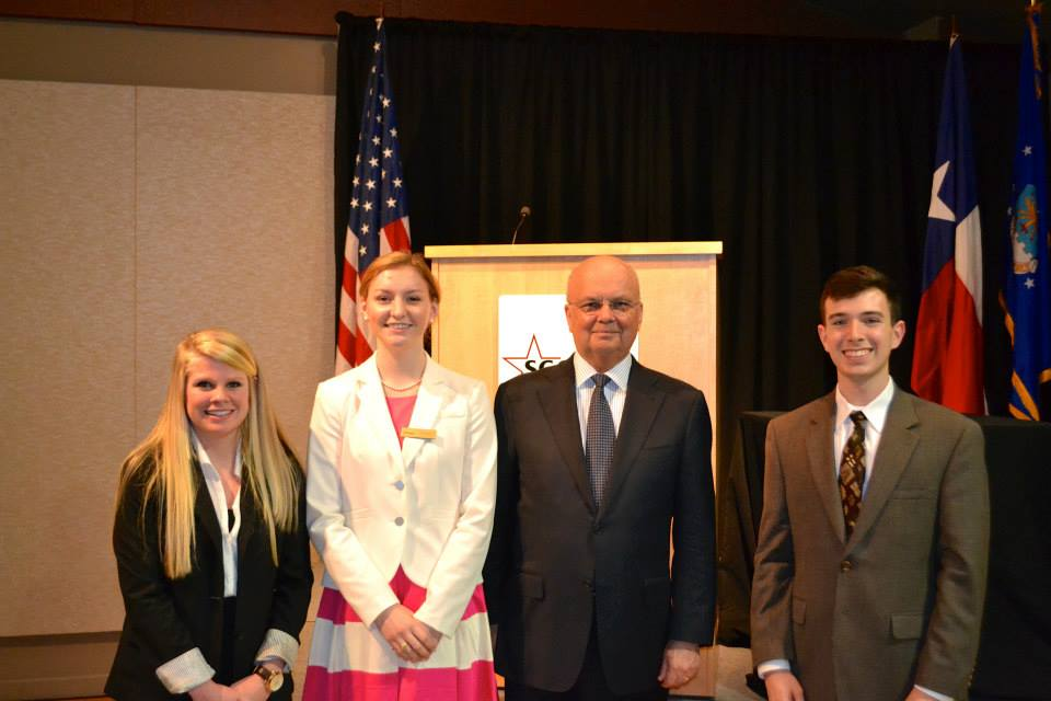 Photo of students with speaker.