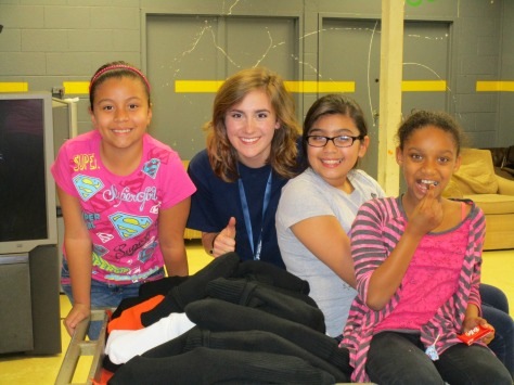 Savannah Sublousky '15, with members of the Boys and Girls Club.