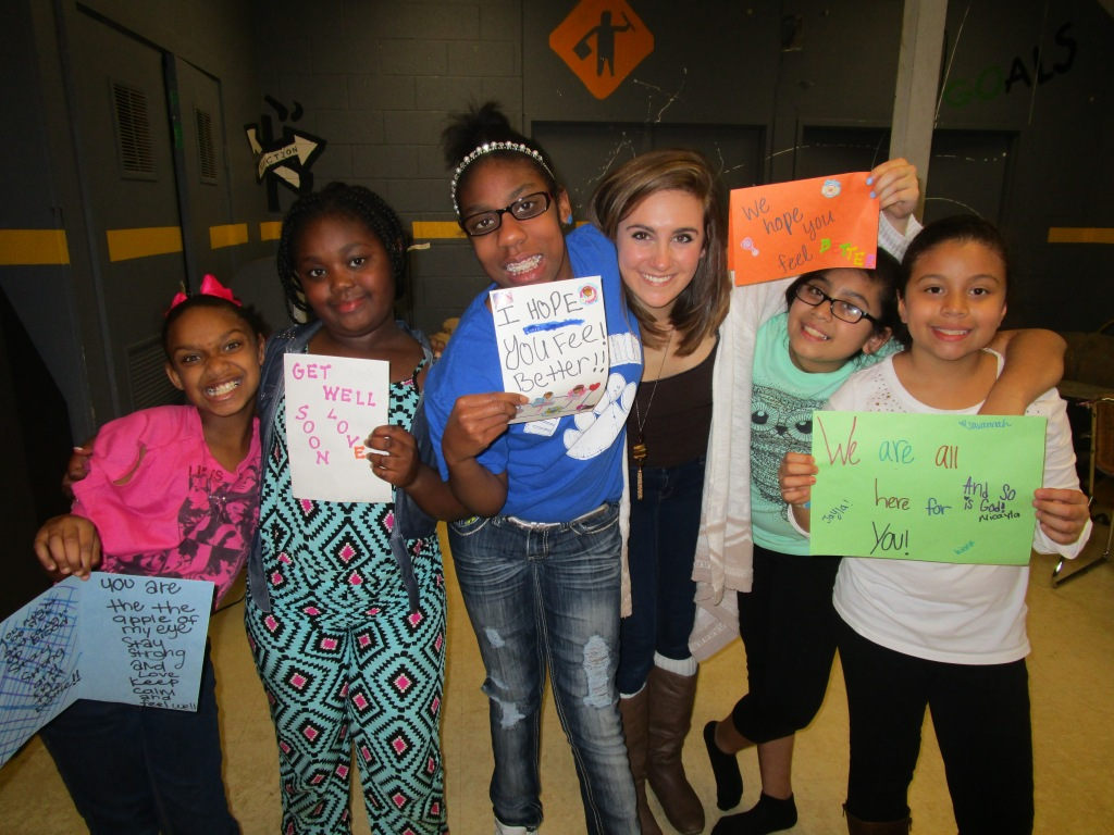 Savannah Sublousky and her students showing off the cards they have made.
