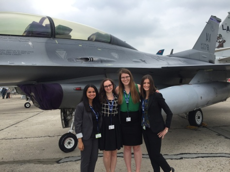 Maura Cadigan '17 with other embassy interns in front of an F-15 Eagle at the Paris Air Show.