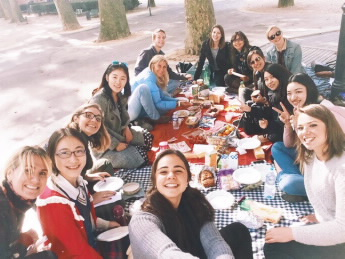 John (top left) with his classmates enjoying a picnic in Grenoble, France
