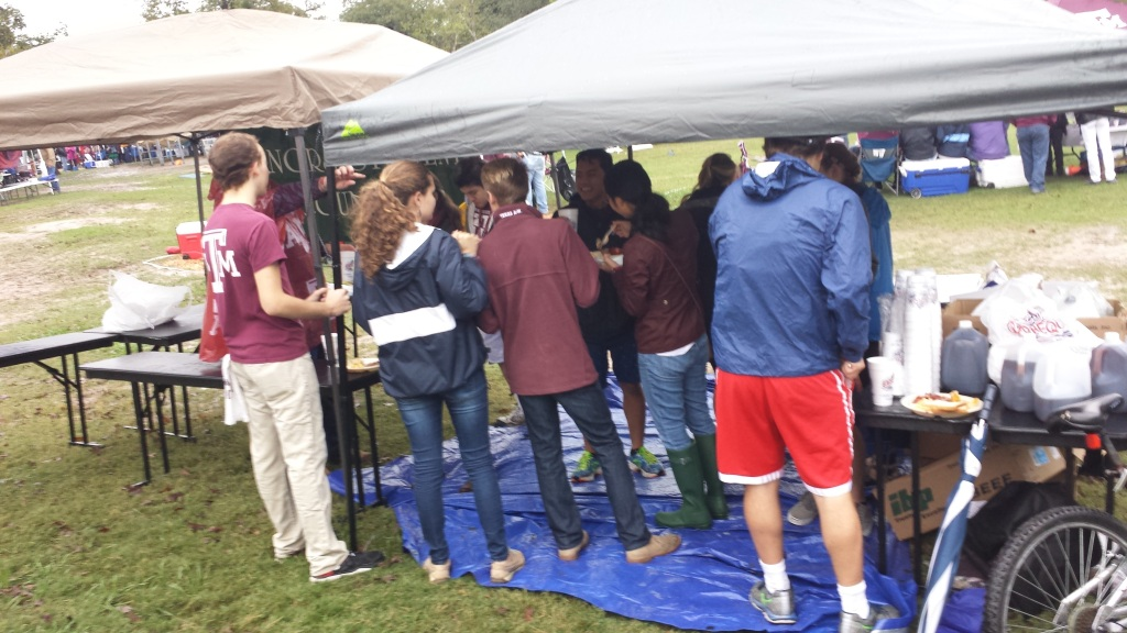 Honors Student Council would not let a few clouds nor rain dampen their Aggie Spirit before the Auburn football game outside of Kyle Field in Spence Park during one of the HSC Tailgates. (November 7th, 2015)
