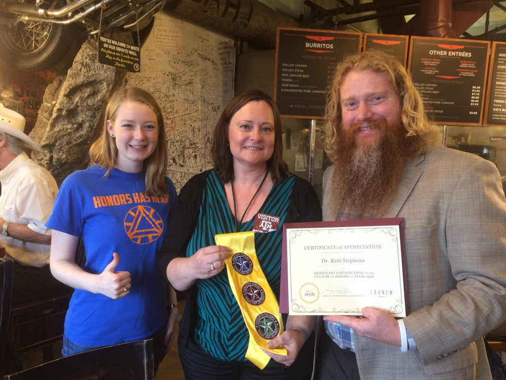 Honors staff Adelia Humme '15 (left) and Jonathan Kotinek '99 present a stole and certificate of appreciation to Keri Stephens '90